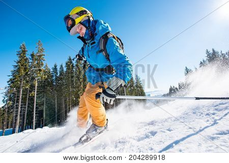 Male Skier Skiing On Fresh Snow In The Mountains On A Sunny Beautiful Day Extreme Fun Happiness Acti