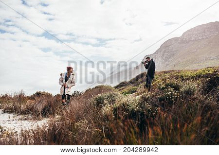 Young Couple On Vacation Taking Photos