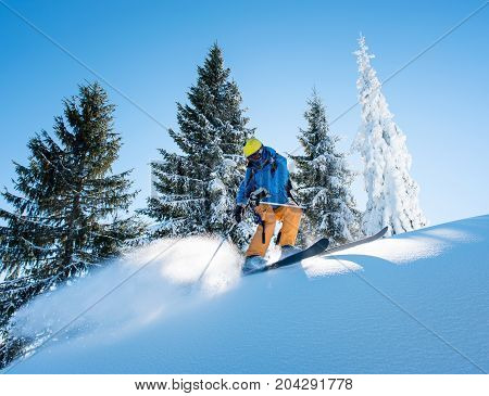Shot Of A Professional Freeride Skier Skiing In The Mountains On A Sunny Winter Day Nature Recreatio