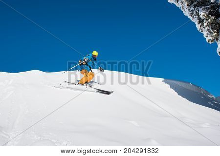 Shot Of A Professional Freeride Skier Skiing In The Carpathians Mountains On A Sunny Winter Day Natu