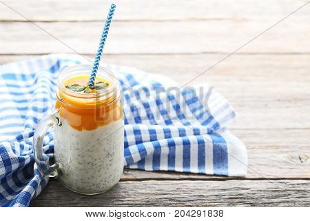 Chia Pudding With Berries In Jar On Grey Wooden Table