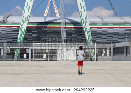 Torino TO Italy - August 26 2016: Outside of the very popular stadium called Juventus Stadium and a boy