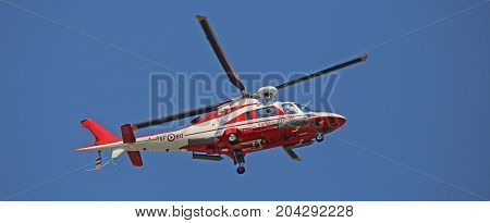 Veneto, Italy - May 26, 2016: Helicopter Of Italian Firefighters Flying High During Rescue Operation