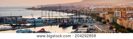 Malaga Spain. Aerial view of apartment buildings and hotels in Malaga Andalusia Spain with sea and port moored yachts