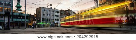 Blurred tram in the center of Bratislava Slovakia in the evening. Famous old buildings.