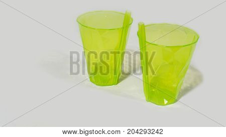 Transparent Green  Plastic Cups With Straw Isolated On White