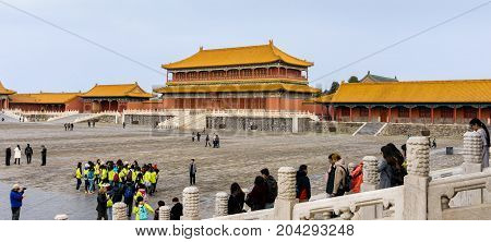Beijing, China - Oct 30, 2016: At the Gate of Supreme Harmony (Taihemen), Forbidden City (Gu Gong, Palace Museum). Tower of State Benevolence is the middle building before a large central courtyard.