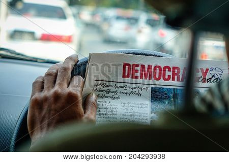 Taxi Driver Reading News In The Car