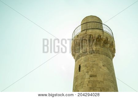 An old mosque minaret Azerbaijan old town. View from bottom