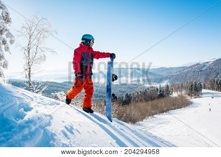 Professional Snowboarder Standing On Top Of A Slope Looking Around Enjoying The View On Winter Ski R
