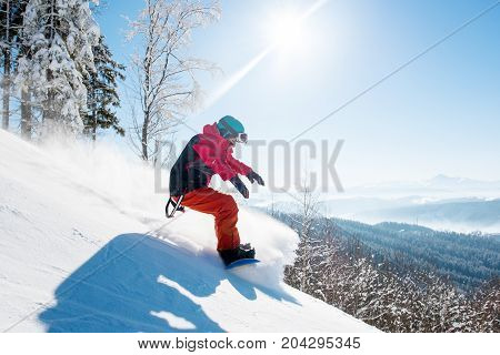Shot Of A Freeride Snowboarder Riding In The Mountains Wearing Snowboarding Gear Beautiful Scenery W