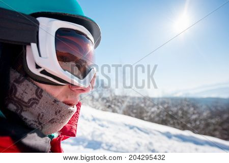 Close Up Cropped Profile Shot Of A Male Snowboarded Wearing Helmet And Skiing Mask On A Beautiful Su