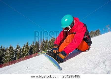 Shot Of A Snowboarder Sitting On The Snow Preparing For Riding The Slope Copyspace Relax Rest Recrea