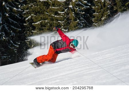 Freerider Snowboarding At Winter Resort. Snowboarder Riding The Slope