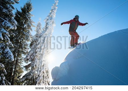 Male Snowboarder Riding Downhill On Dangerous Slope In The Winter Mountains Copyspace Freeride