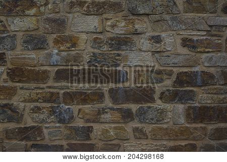 Background of old brown stone wall texture photo