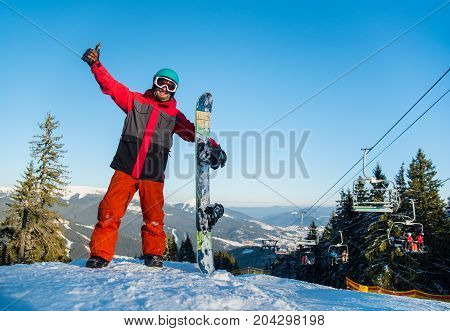Freerider Snowboarder Smiling To The Camera, Showing Thumb Up, Standing To The Top Of The Mountain W