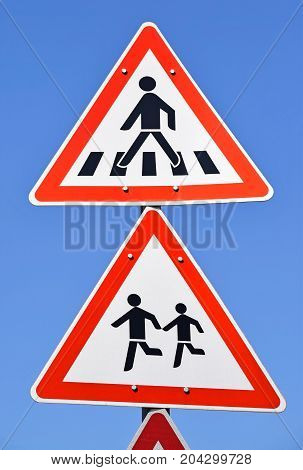 Pedestrian crossing sign on the street in the city