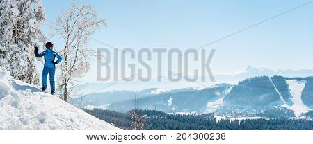Panoramic Shot Of A Woman Skier Resting On Top Of The Mountain Observing Nature At Bukovel Ski Resor