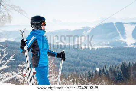 Happy Female Skier Enjoying Stunning Scenery In The Winter Mountains Ski Resort, Looking Away, Holdi