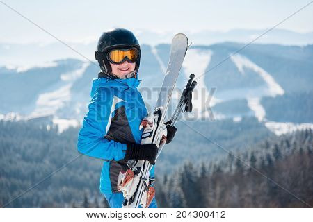Close-up Portrait Of Happy Female Skier Smiling To The Camera Wearing Skiing Gear Copyspace Happines