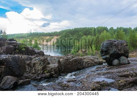 In the ancient volcano in the cloud cloudy day Karelia Russia.