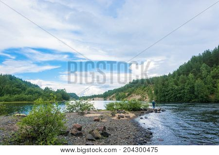 A fisherman on a Pioneer channel in the vicinity on a summer day Karelia Russia.