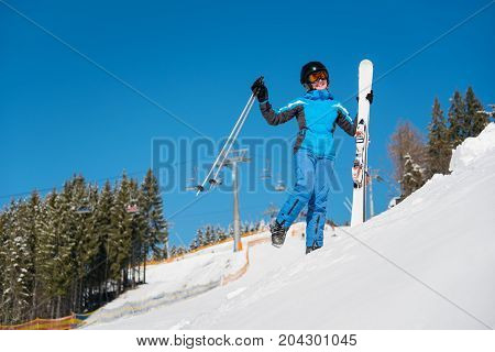 Full Length Shot Of A Cheerful Woman Skier Having Fun On The Slope At Ski Resort In The Mountains, S