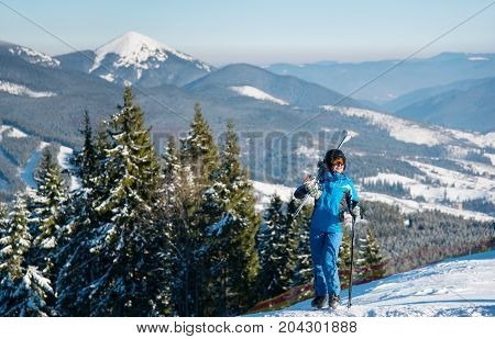 Female Skier Standing On Top Of A Hill Enjoying Beautiful Scenery On The Background Copyspace Winter