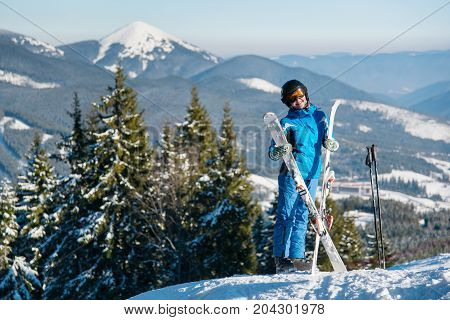 Happy Female Skier Wearing Ski Equipment Posing On Top Of The Mountain On A Sunny Winter Day Copyspa