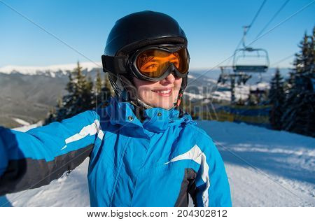 Close-up Portrait Of Smiling Female Skier, Taking A Selfie While Resting On Top Of The Mountain Obse