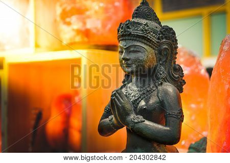 female Indian statue pray god goddess lakshmi