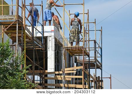 Construction workers at work in a height