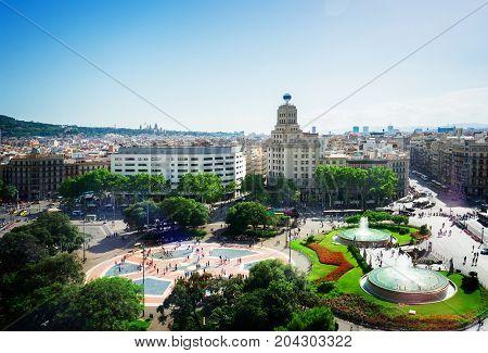 Plaza Catalunia famous square of Barcelona, Spain, toned
