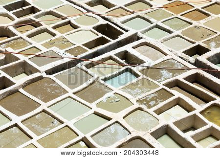 Closeup of white vats at a tannery in Morocco Africa.