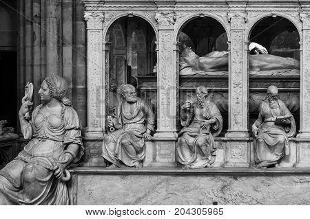 Saint-Denis France - July 02 2017: Tomb of Louis XII and Anne de Bretagne at the Basilica of Saint Denis (Basilique Saint-Denis). Medieval abbey where the kings of France and their families were buried is royal necropolis of France. (Black and white)
