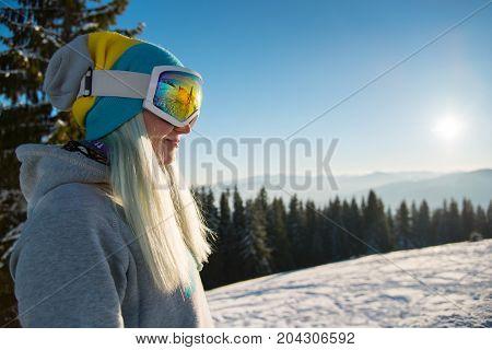 Horizontal Profile Shot Of Cheerful Woman Snowboarder Wearing Skiing Mask Smiling Looking Away Resti