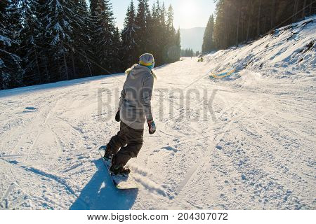 Rearview Shot Of A Snowboarder Skiing The Slope On A Beautiful Winter Sunny Day Copyspace Sunlight F
