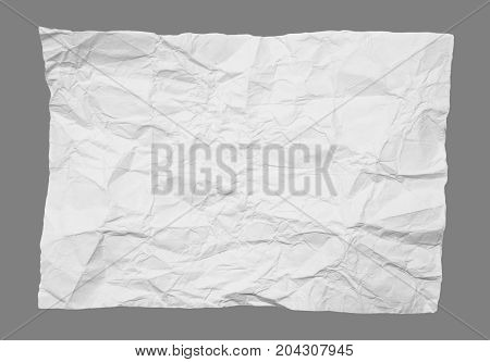 crumpled white paper on a gray background