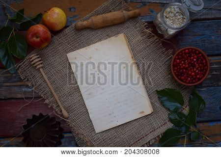 Composition Of Notepad, Apples, Cranberries, Rolling Pin, Molds For Muffins, Oatmeal. Preparation Fo