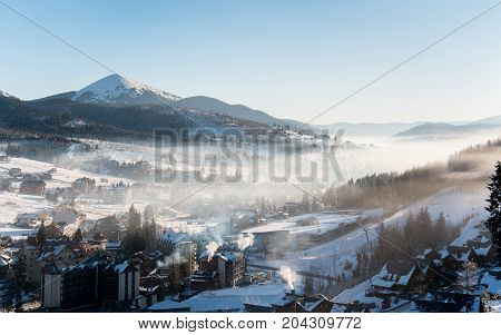 Beautiful Morning Landscape. The First Shadows Of Raising Sun On Winter Mountain Slopes In A White H