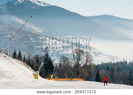 Shot Of A Skier Riding Down The Hill In The Carpathians Mountains On A Beautiful Sunny Morning At Sk