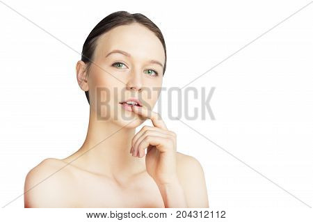 Attractive Woman with Fresh Skin Looking at Camera Isolated on White