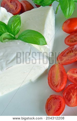 Caprese salad with buffalo mozzarella Salad with tomatoes and buffalo mozzarella, photo series, closeup