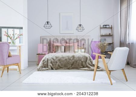 Poster Above Gray Bed