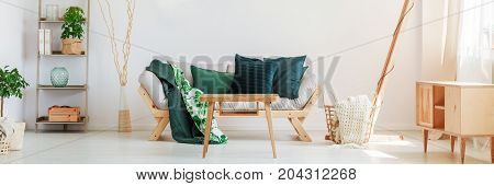 Sofa With Greenish Pillows