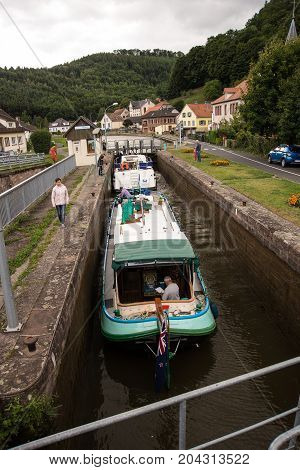 LutzelbourgFrance-September 062017 Boats enter the locks at the river Zorn on the Canal de la Marne au Rhin