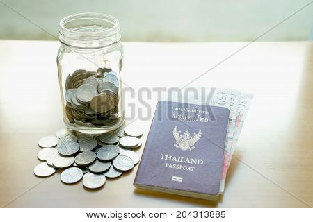 Savings jar with currency for travel, collecting money