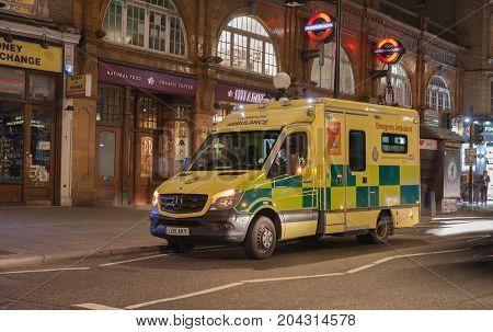 Earls Court Tube Station,  London - September 6,  2017: London ambulance standing by the tube station Earls Count on September 6,  2017 in London United Kingdom