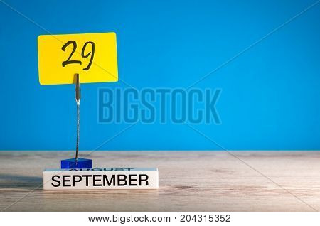 September 29th. Day 29 of month, Calendar on teacher or student, pupil table with empty space for text, copy space.